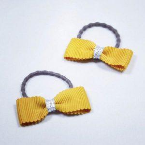 BUSYLIZZIE 300972 rusettihiuspampula, Yellow